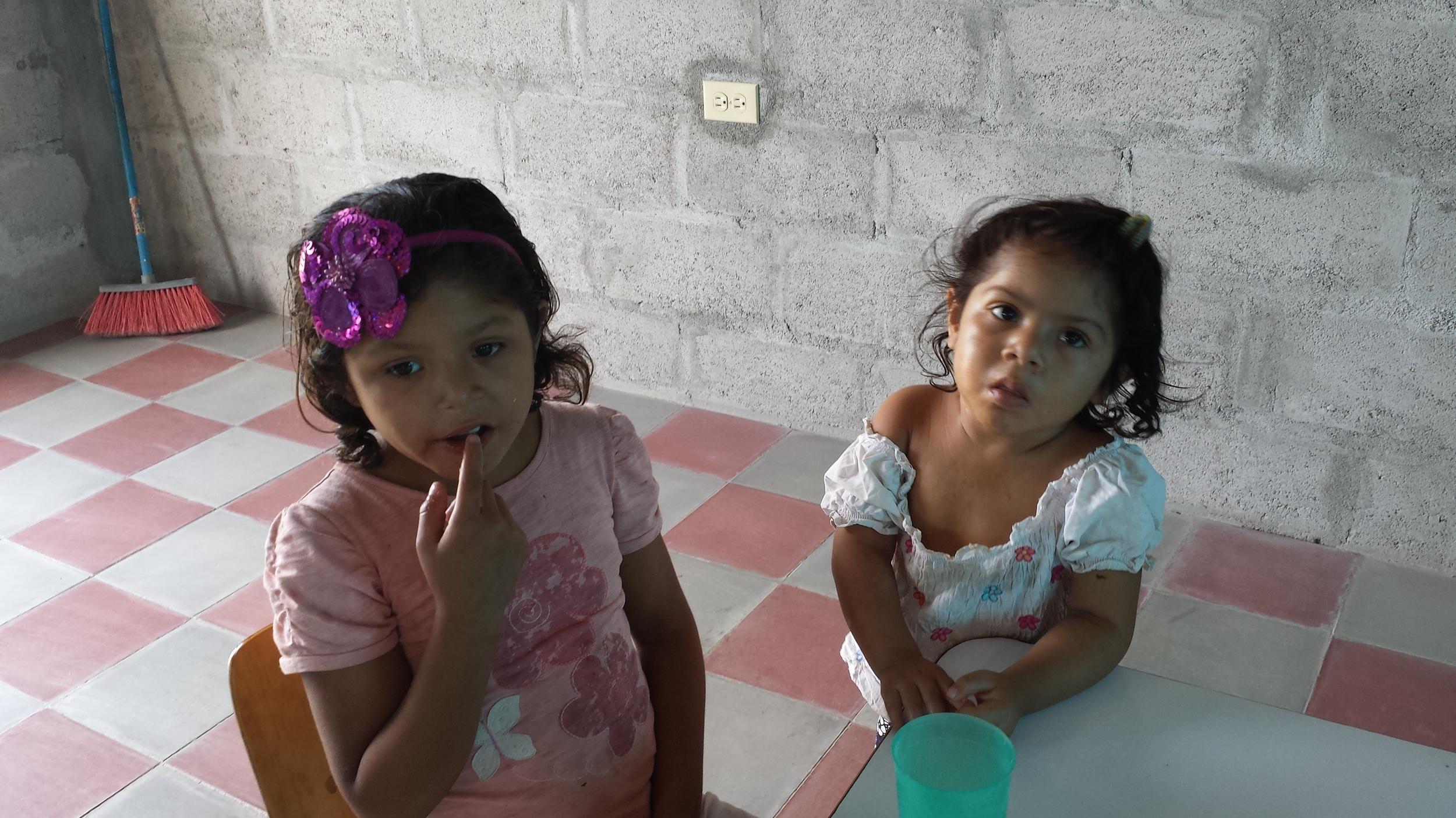 Enjoying lunch at the feeding center (2).jpg