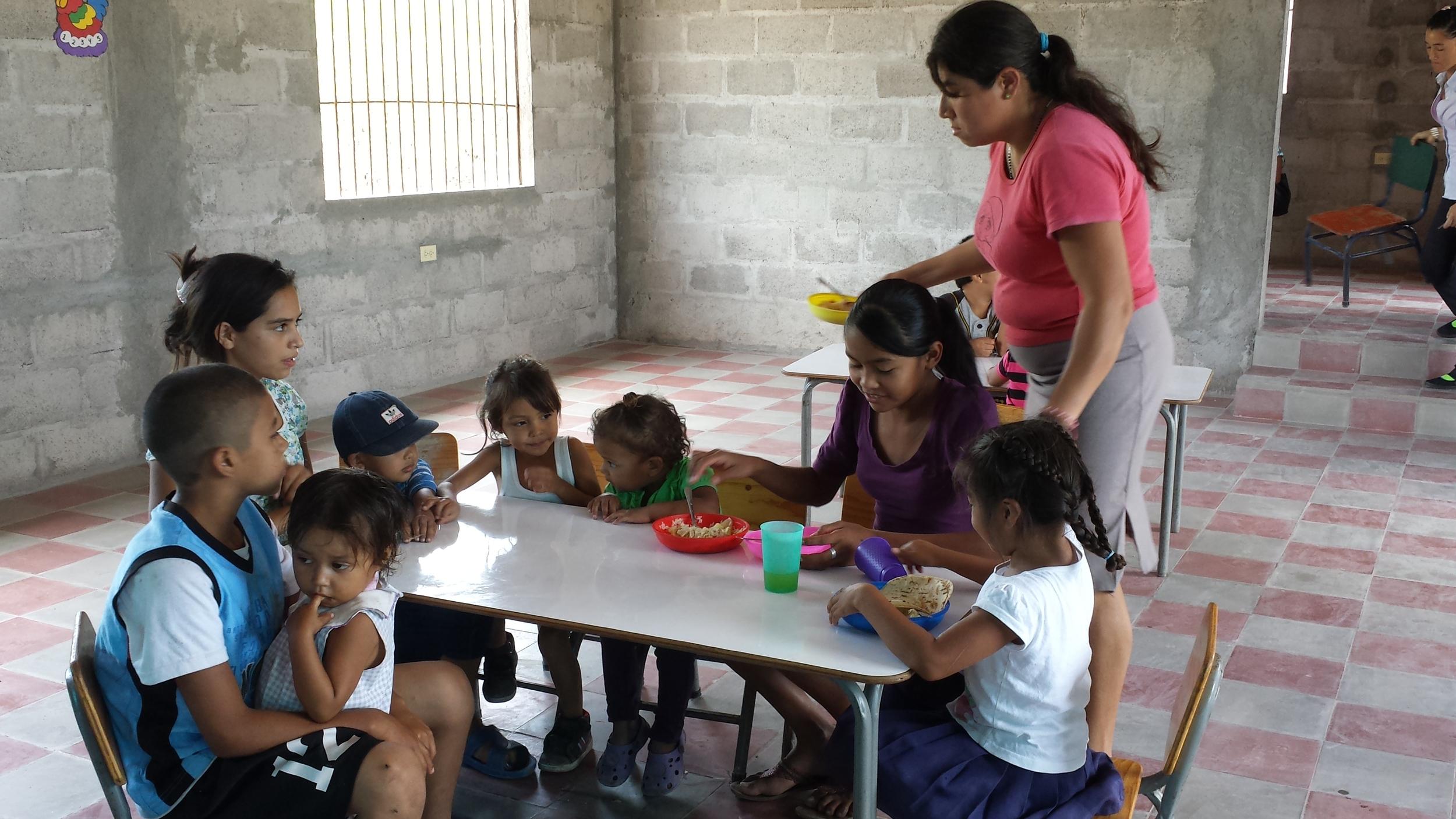 Enjoying lunch at the feeding center (3).jpg