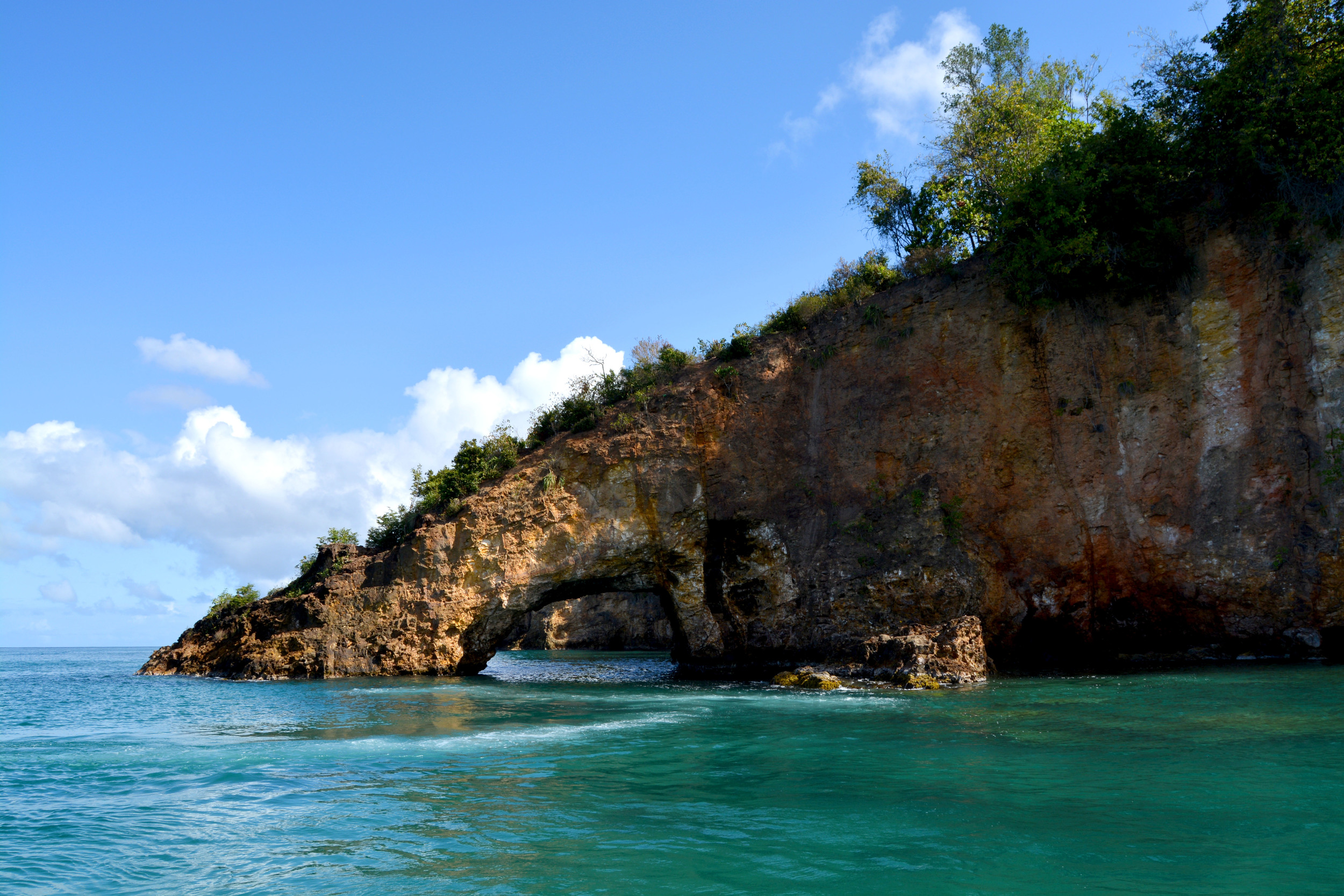 """Gros Islet, St. Lucia - This natural rock Bridge has a few names; the """"tunnel of love"""" or the """"lady's slipper"""" or the """"lady's shoe""""."""