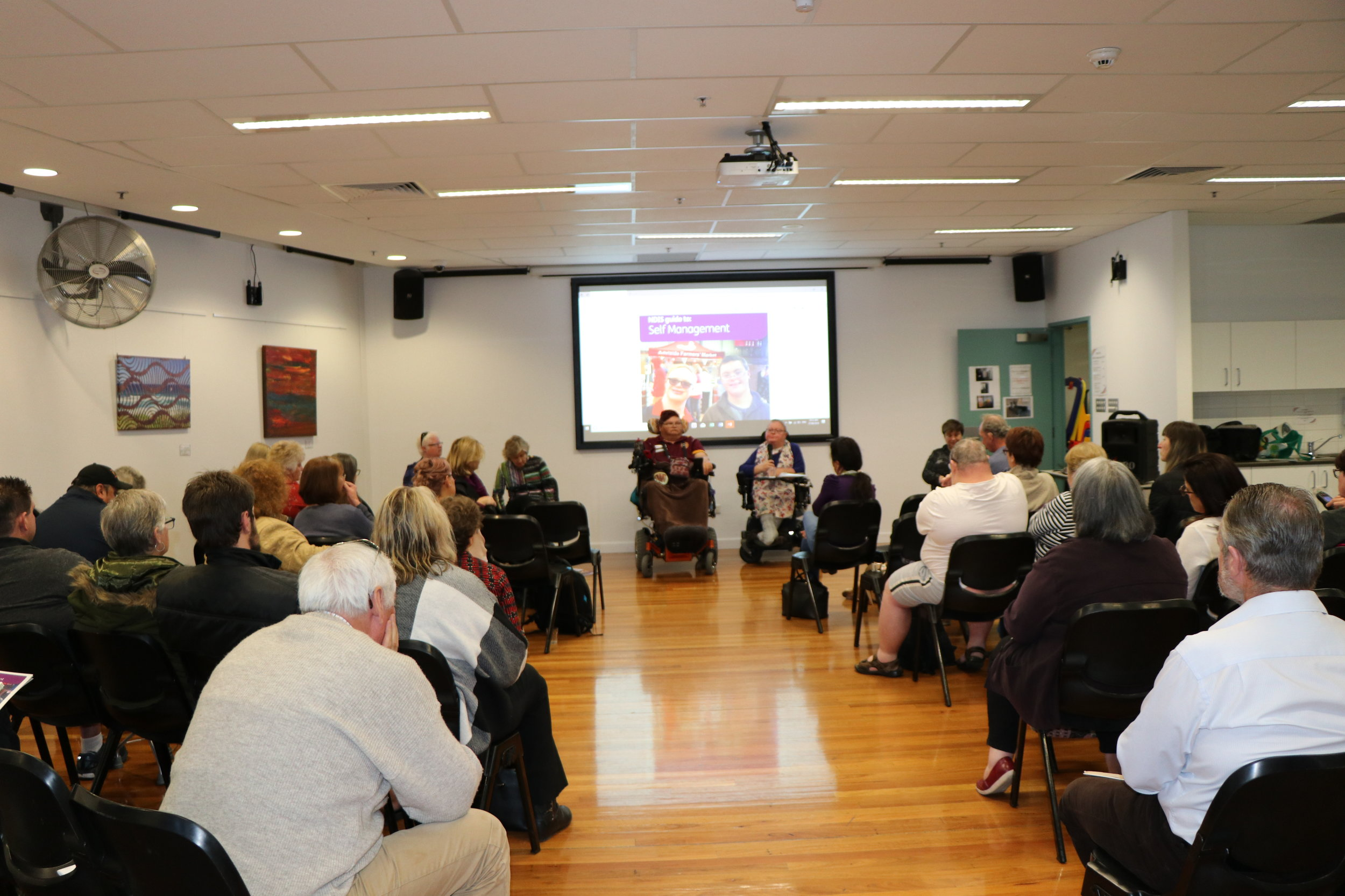 Image of participants listening to the panel, Raelene, Marita, Tania and Carolyn (from left to right)