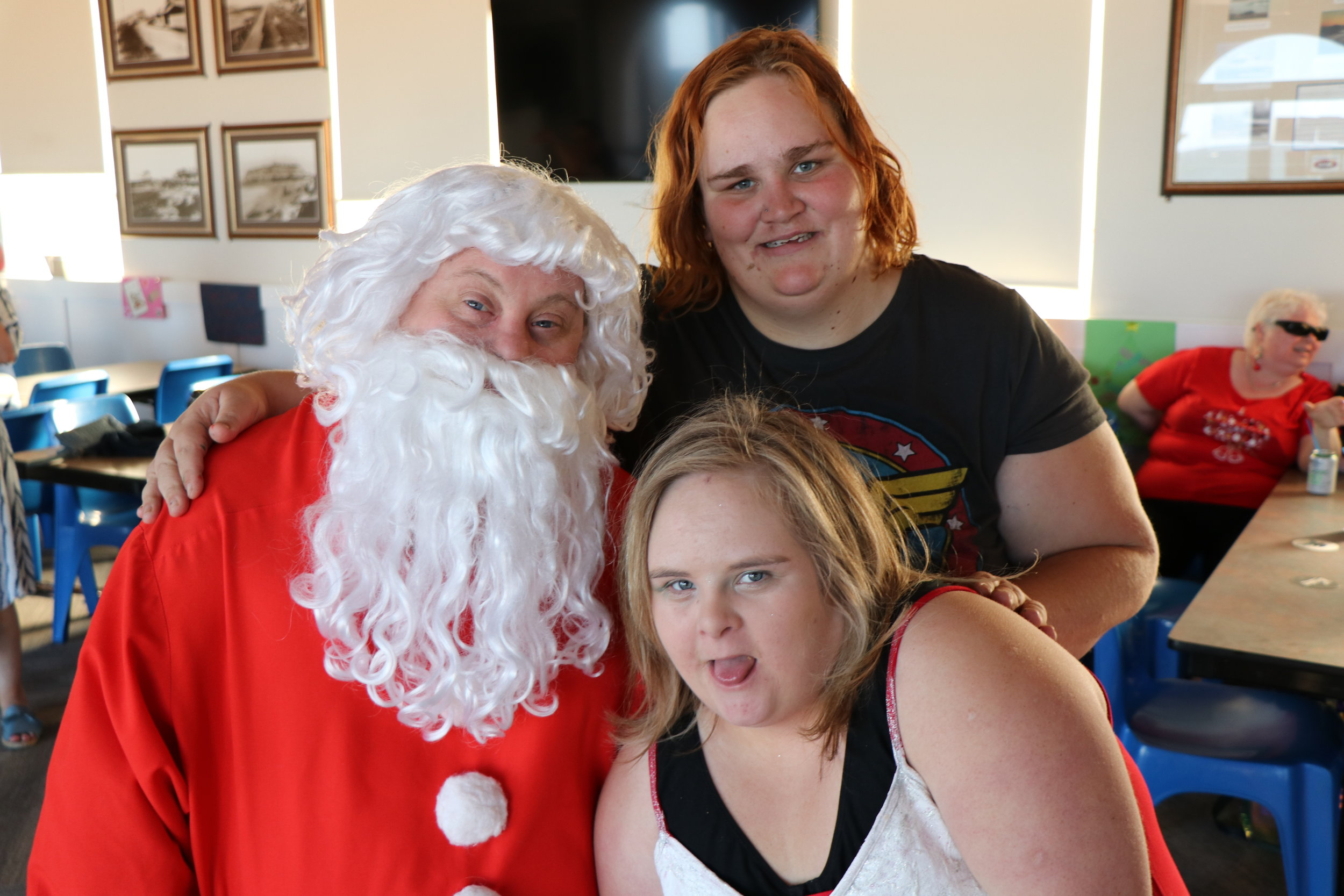Photo of Santa Claus with two women.