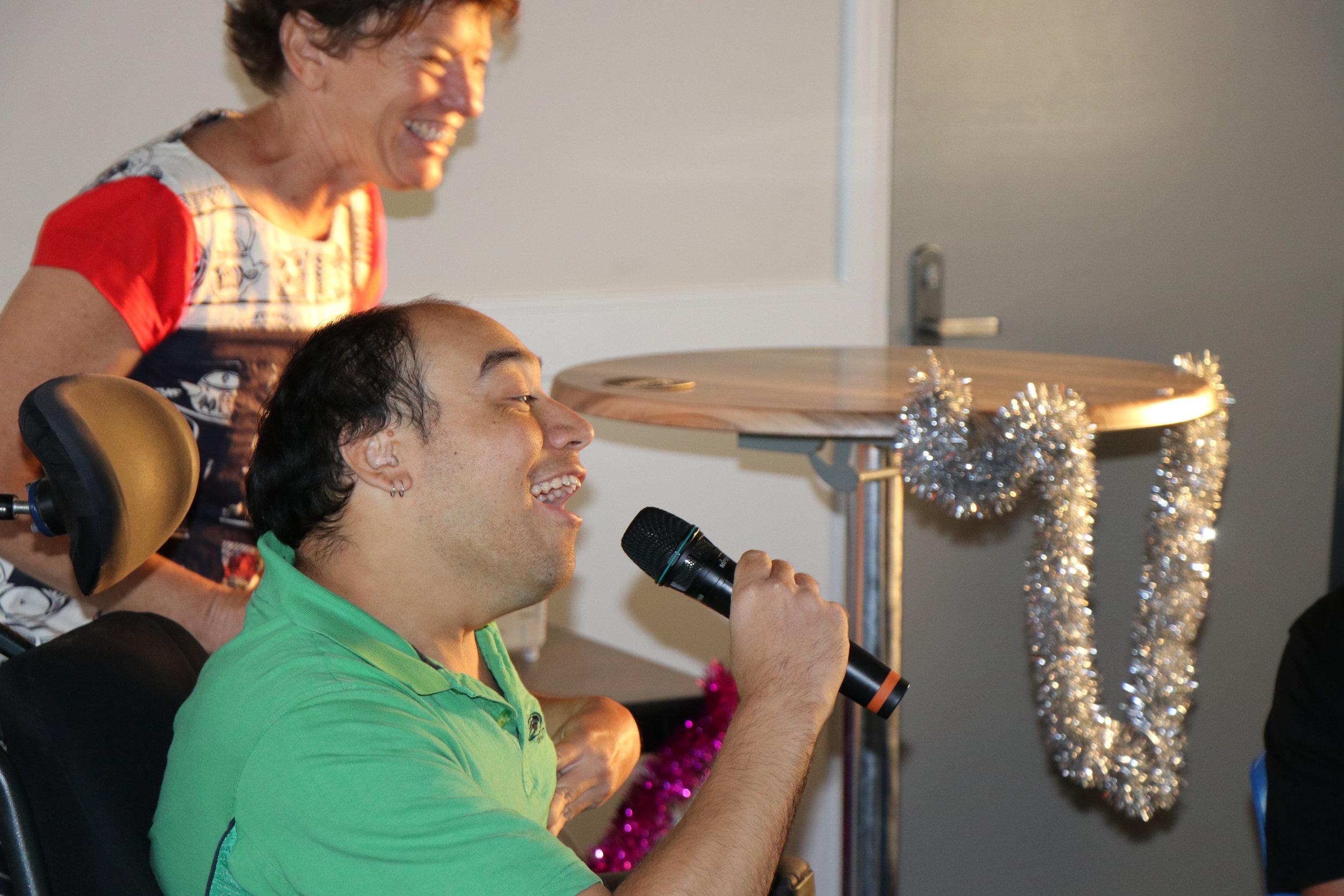 Photo of a man singing karaoke.