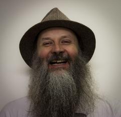 Image description: Portrait of Andrew laughing.