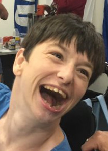 Image description: Cayt laughing out loud.