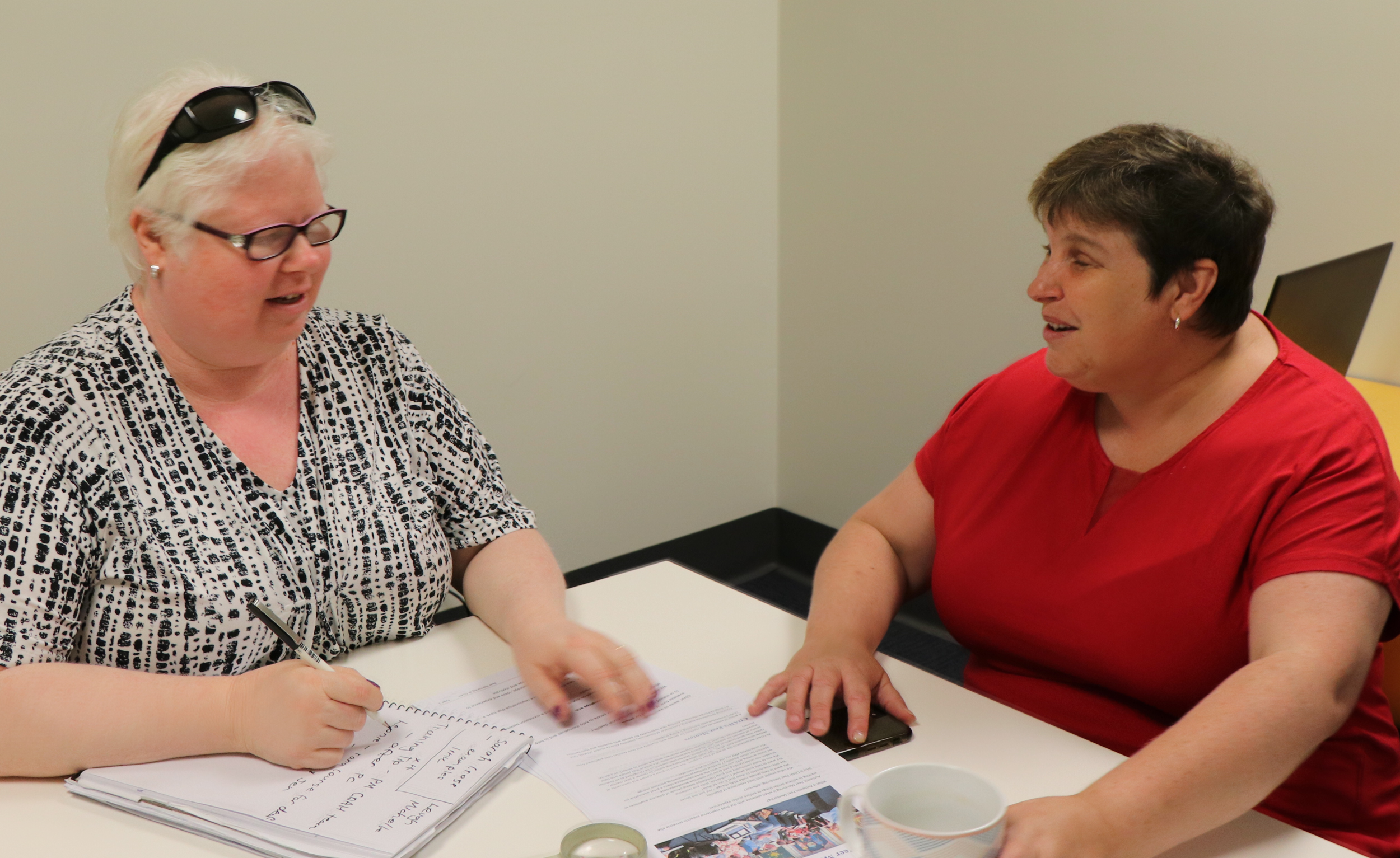 Raelene Block (left) and Cath Mahony are preparing their presentation for the 'Inclusion Training' workshop.