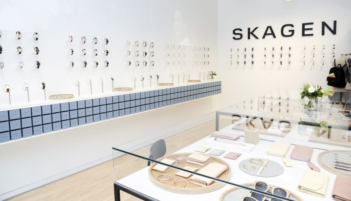 Prominent branding and functional packaging display at the Skagen store in Paris Champs Elysees.