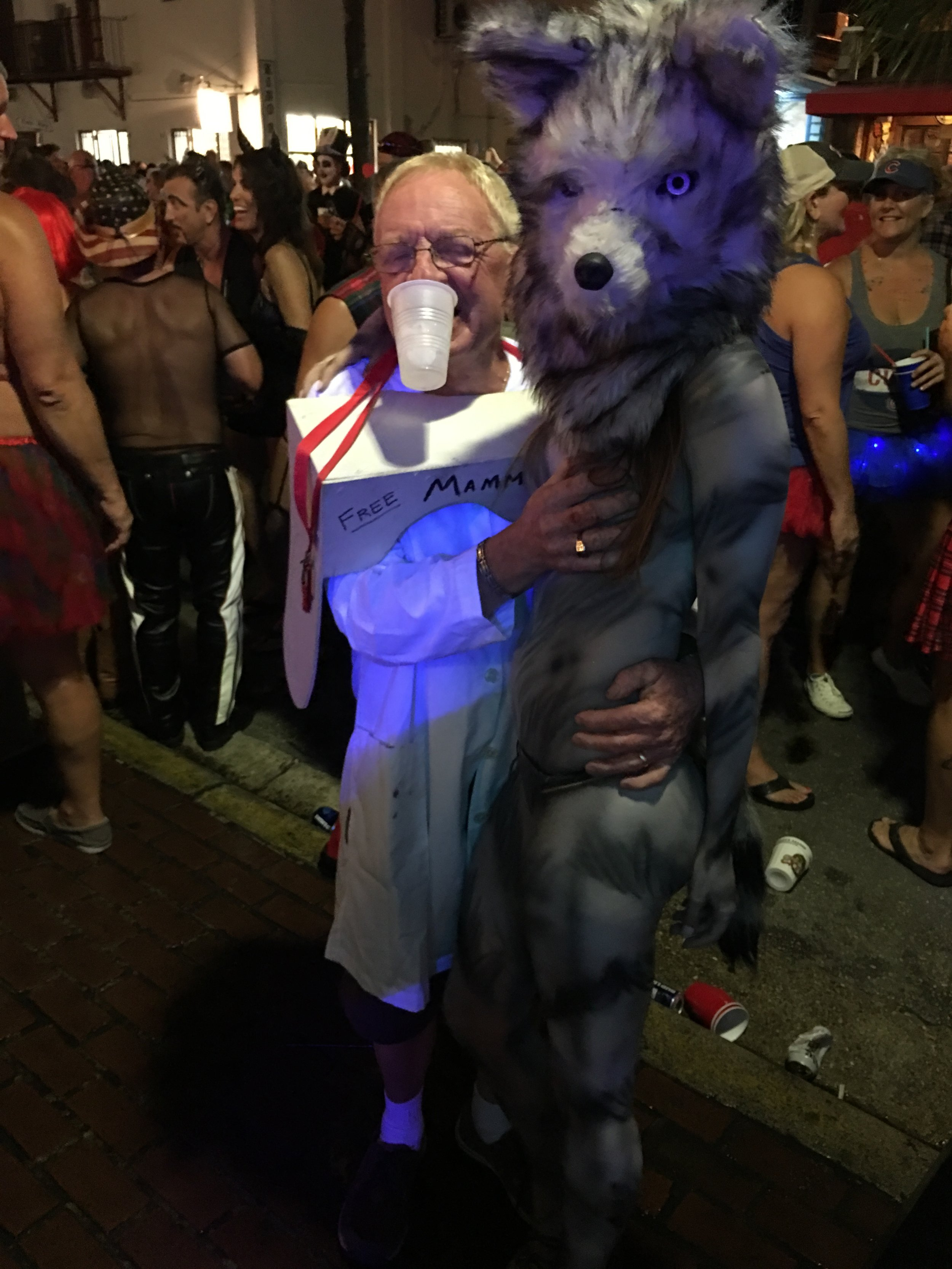 Alessandra Torre in wolf body paint at Fantasy Fest 2016 in Key West - nude with Free Mammograms costume man