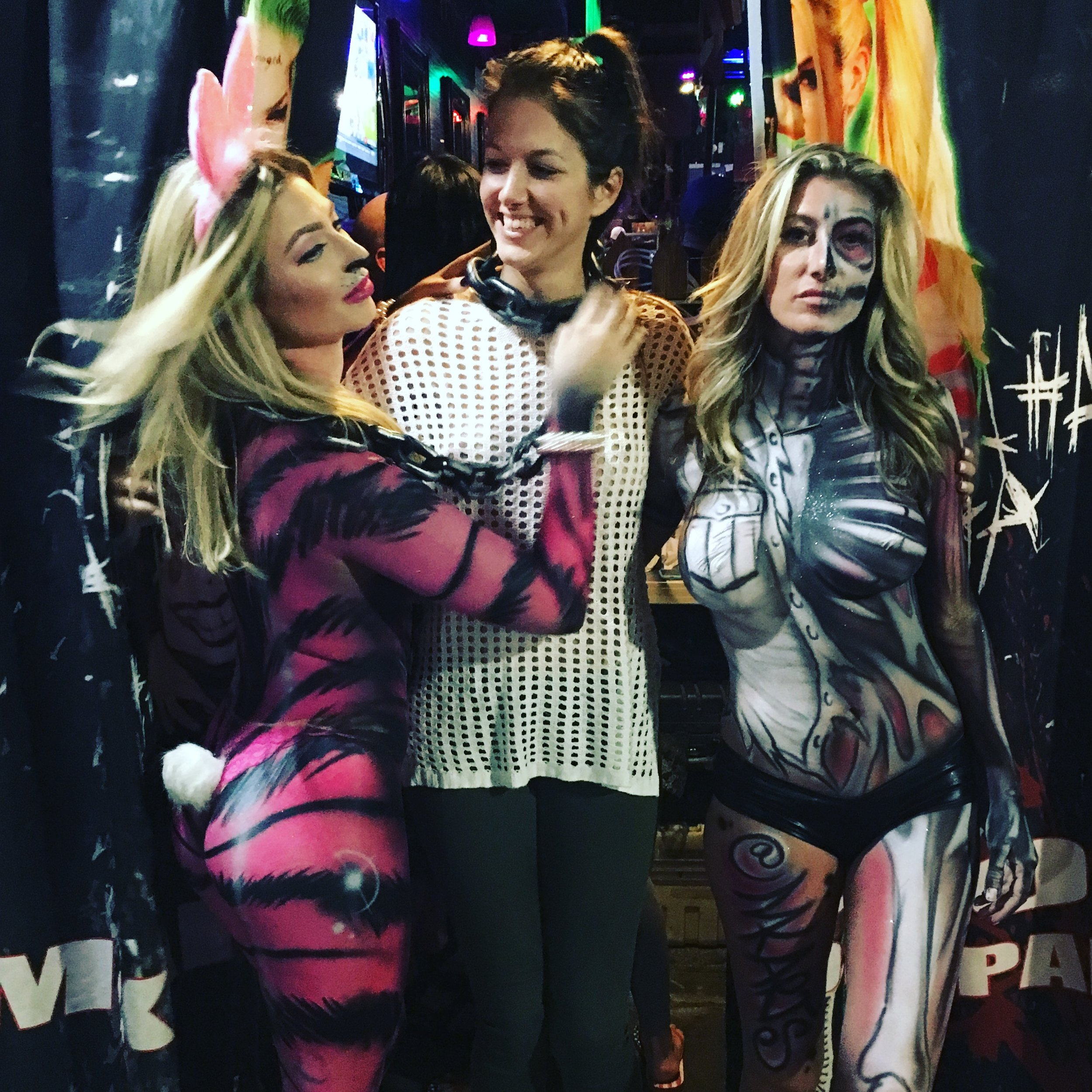 Alessandra Torre with two body paint models. The artist is mkarts.com