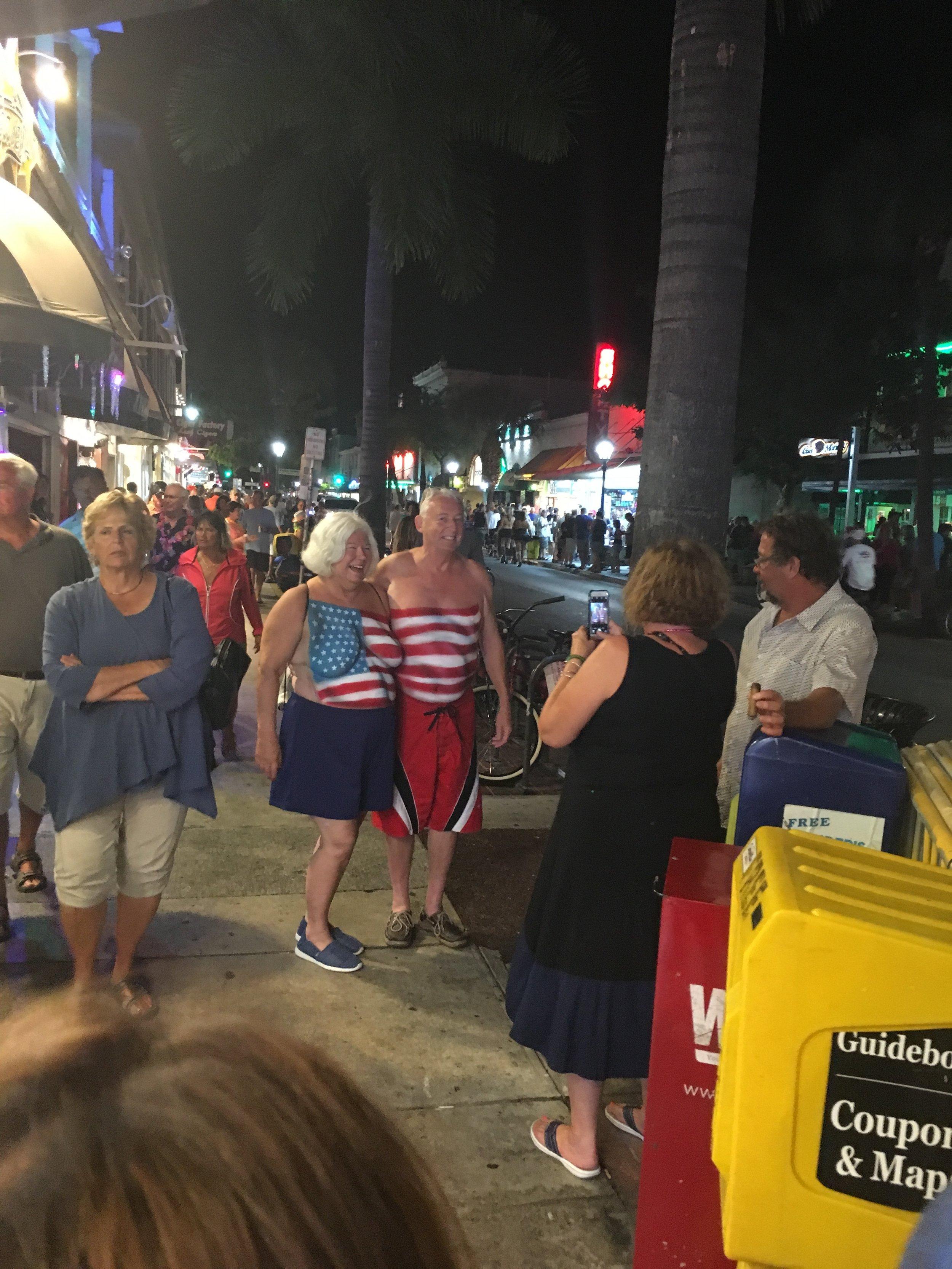 fantasy fest 2016 key west crowd shots pictures body paint nudity american flag couple patriotic