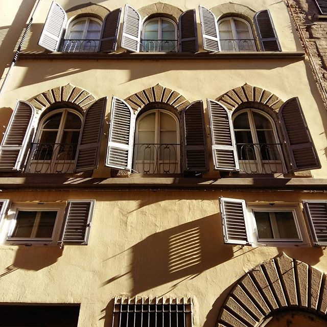 Shutters & shadows | Another palazzo on the gently curving Via dei Bardi. I love the shadow-play of the rows of shutters (which reach another three stories up to the sky!). ▪ #viadeibardi #firenze #morningwalk #lookingup #recessandrelief #lightandshadow #texture #morninglight #stone #building  #renaissance #palazzo #architecture #beautyinthedetails #windows #shutters #neutralpalette #builttolast #florence