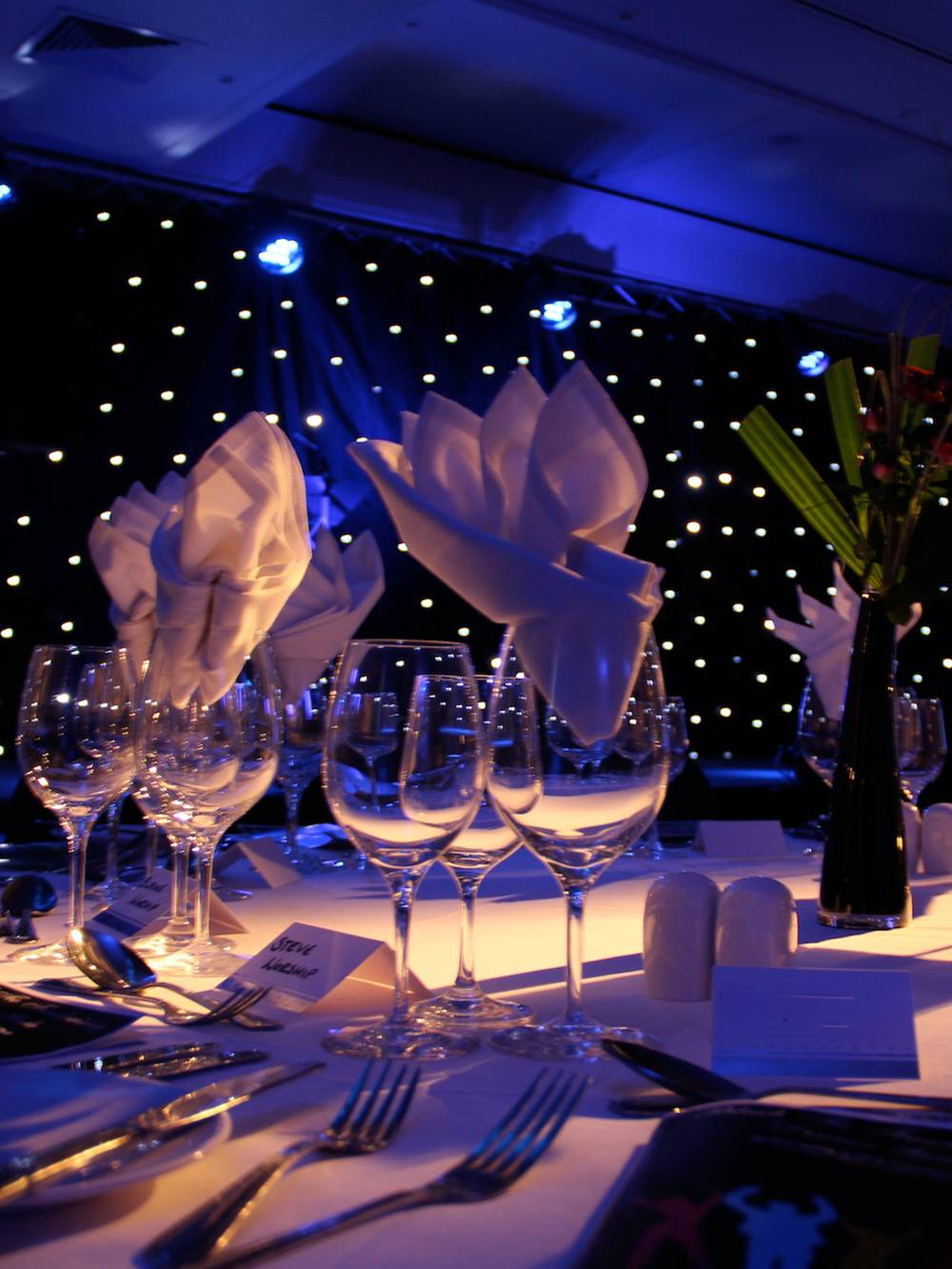 Gala dinners require particular attention to lighting, and staging as well as AV. This photo was taken at Mere Golf Resort just outside Manchester.