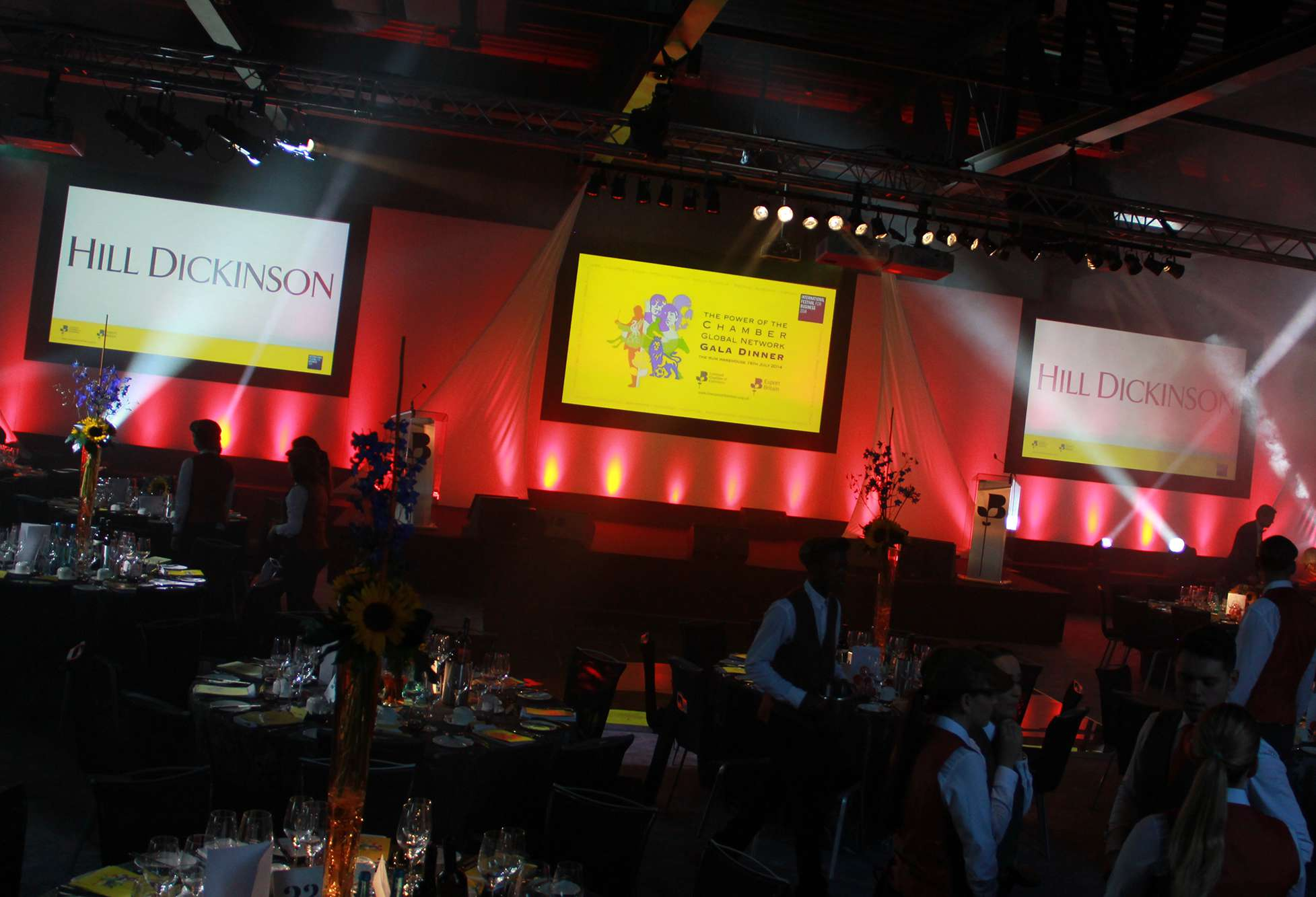 Three screen stage set, staging, lighting and audio visual set up for a gala dinner in The Rum Warehouse at The Titanic Hotel.