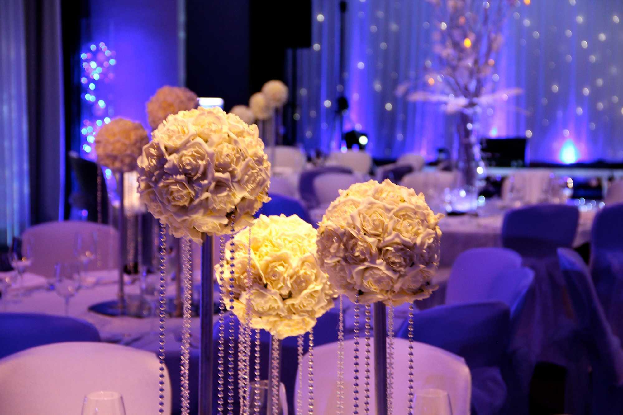 Winter Wonderland Themed Wedding Lighting & Venue Dressing at Hilton Hotel Liverpool. Blue Uplighters, Snowflake Gobos, Winter Wonderland Theme Props.