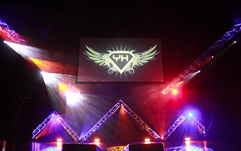 Truss-based stage set with large projection screen for an awards ceremony in Cheshire.