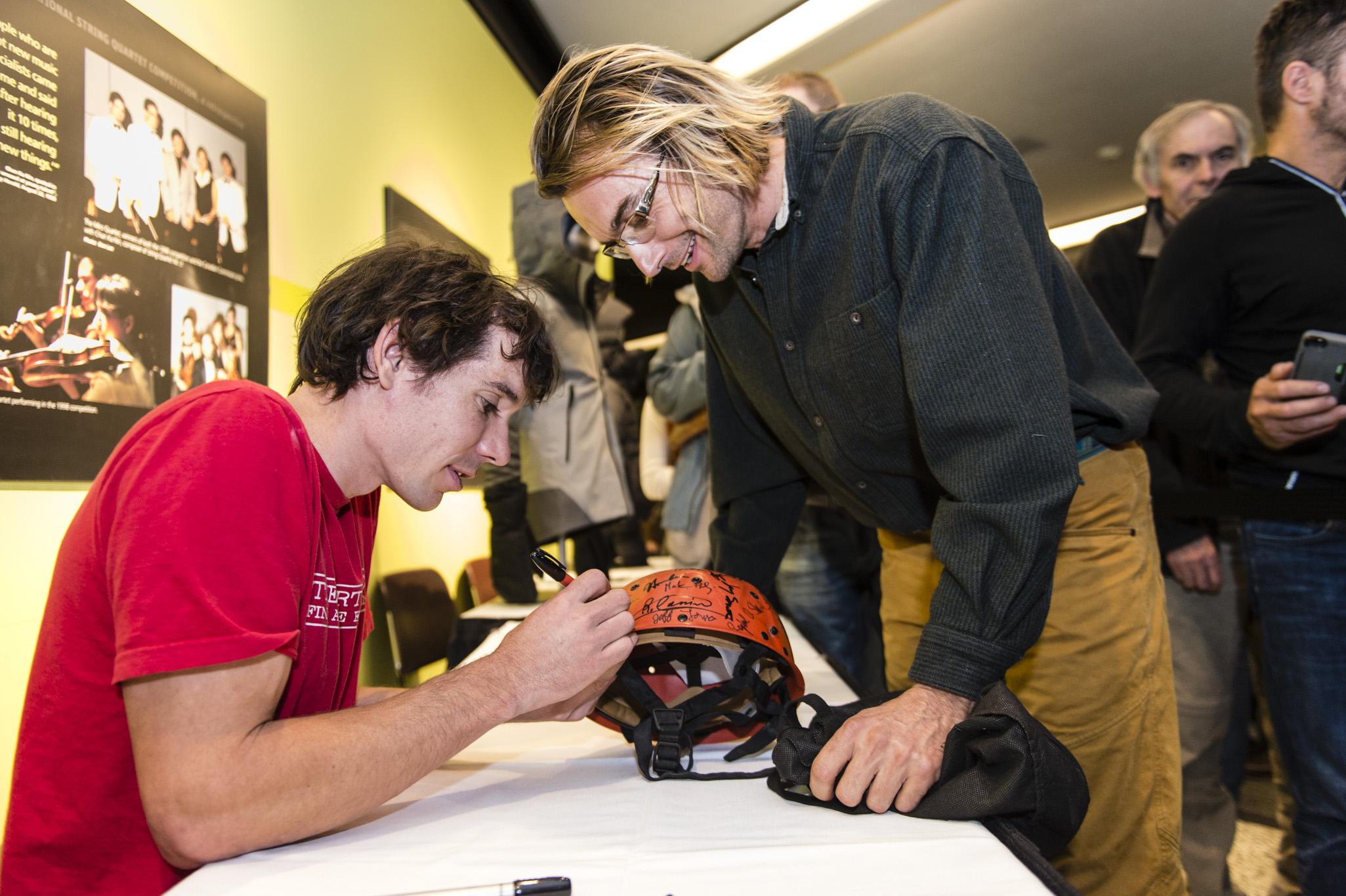 Alex Honnold signing hats by Rita Taylor.jpg