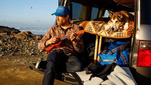 Ben Moon in van with dog