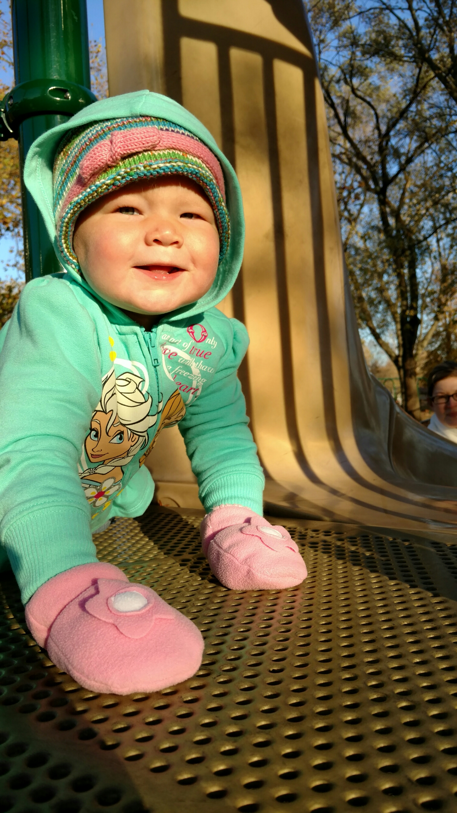 Emma likes the slide at the playground. Her life pretty much rules right now.