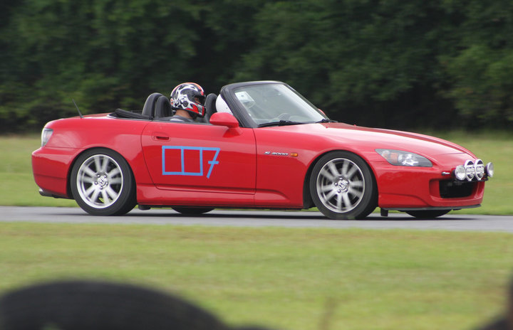 The author on track at his first track day. Instructor Khoi Nguyen riding shotgun. Check out those rally lights!