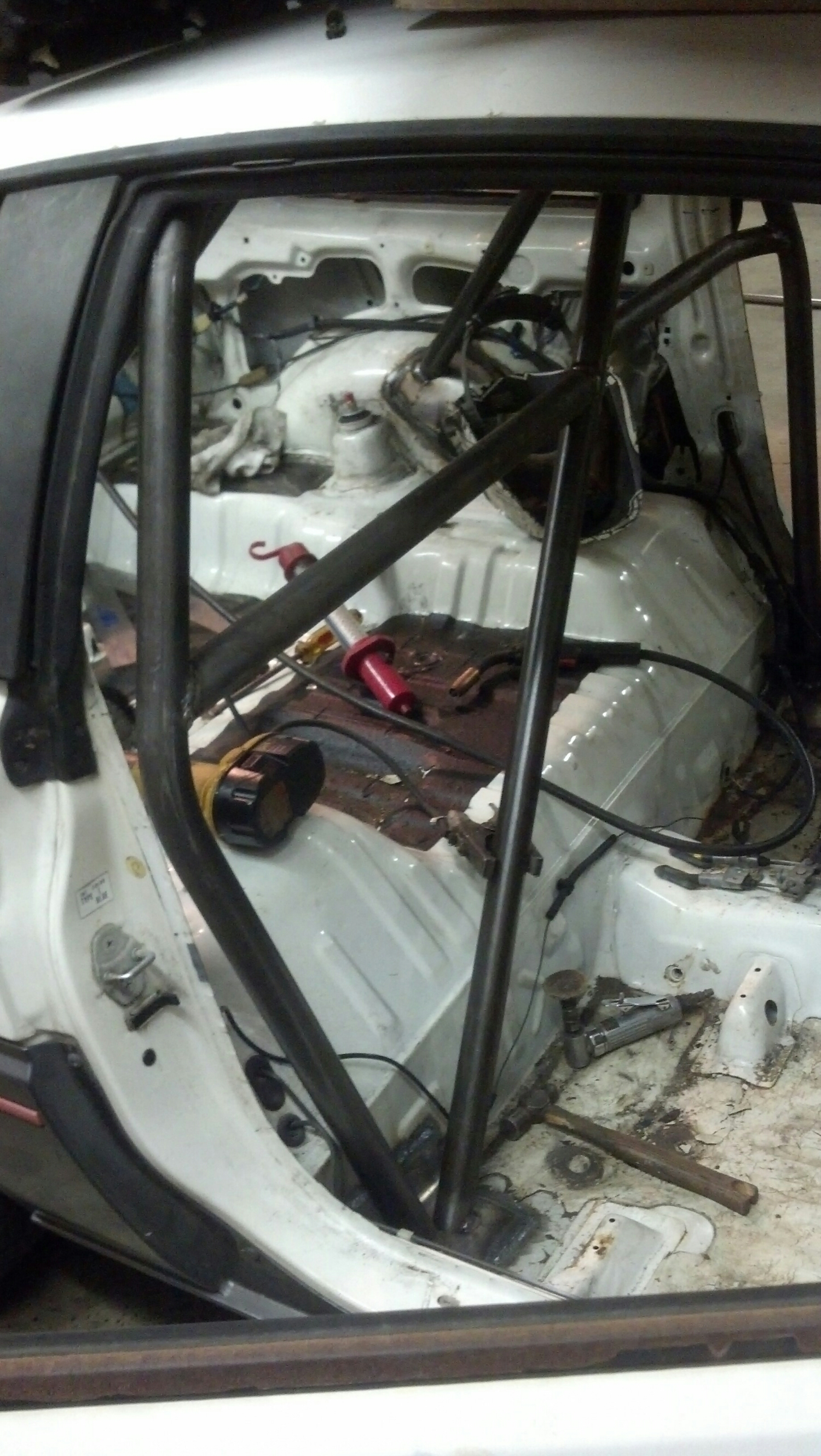 """Its hard to find pics for an article on rules, so here is an in process cage fabrication pic of """"the honey badger"""" (A someday- feature car here)"""