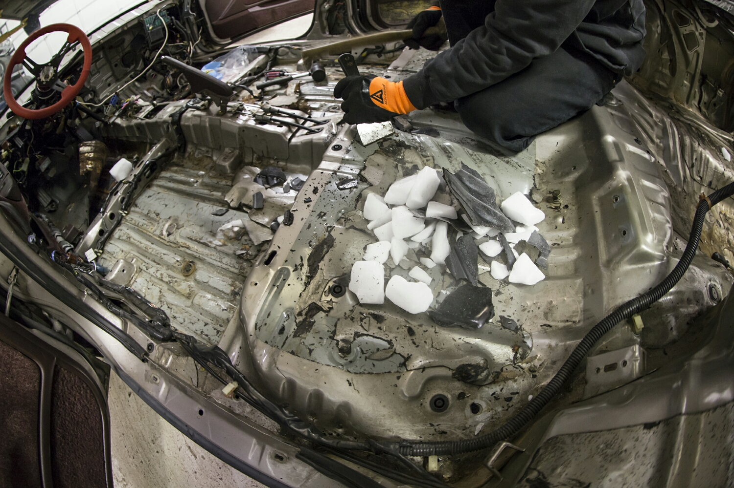 Dry Ice is cheap, and when you break it up, lay it over sound deadening, and wait a few minutes, it makes that sound deadening very hard. Strike the sub-zero tar-filled goop with a hammer and it comes off much cleaner that trying to scrape it off at room temperature