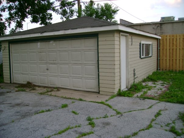 unhappy with your garage?  do something about it.....like....pull it over with a big tractor and throw it into a dumpster.