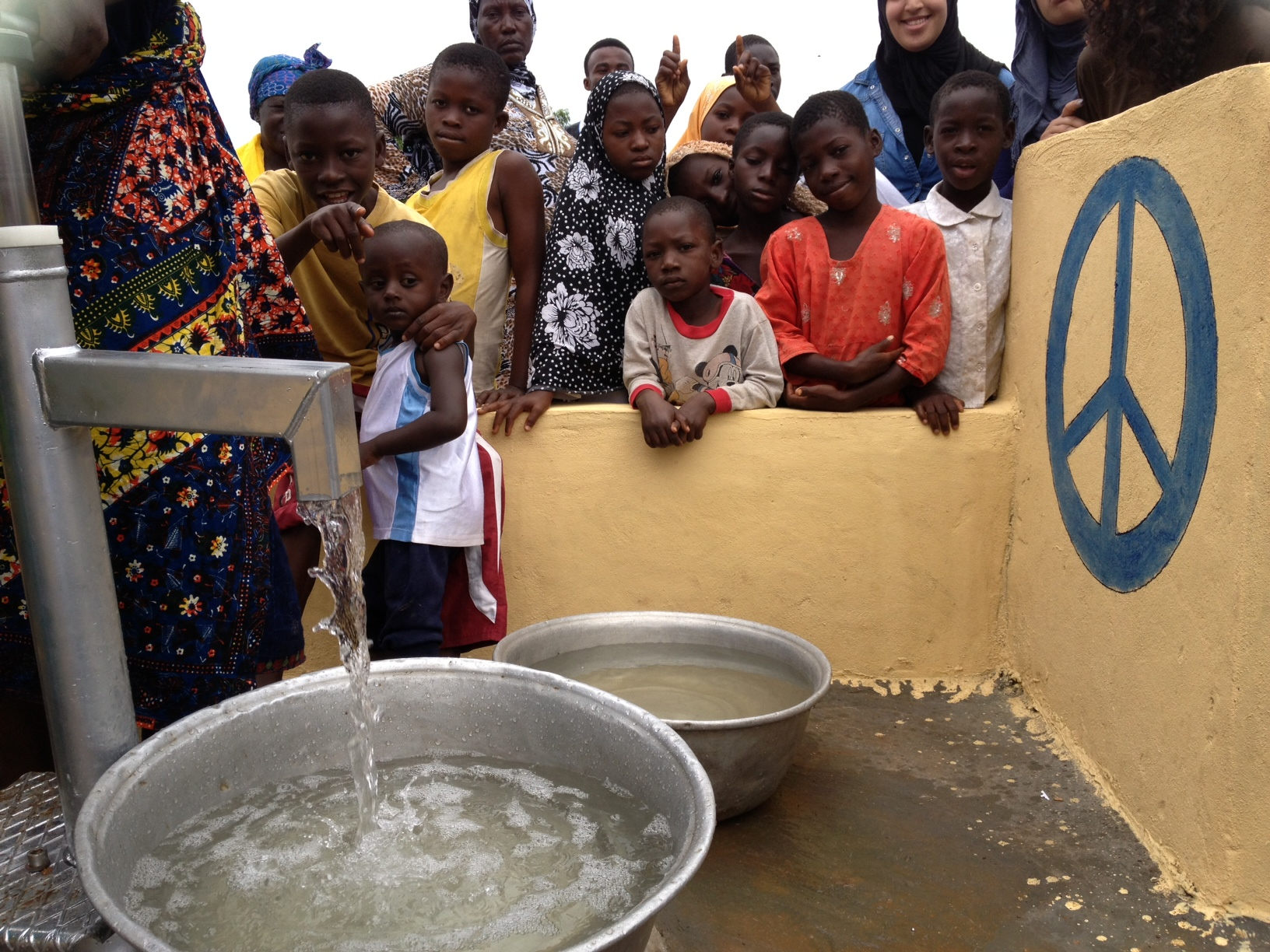 water pouring and peace sign.JPG