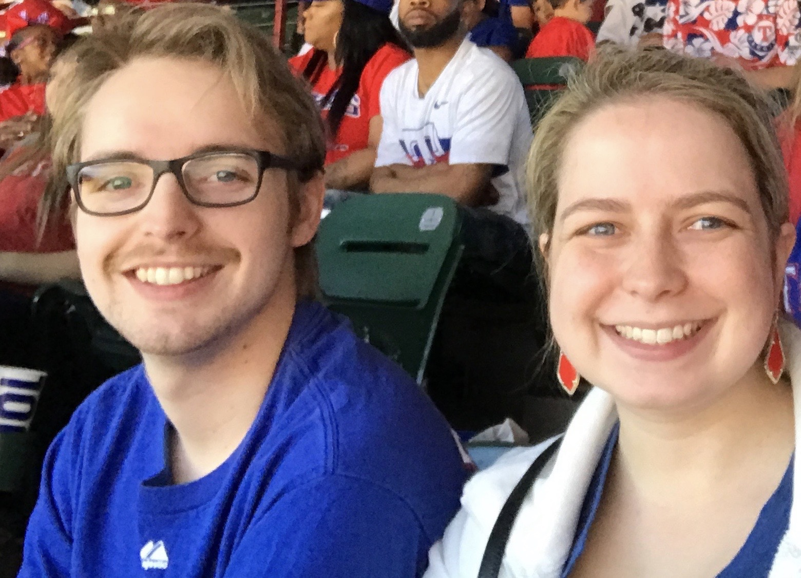 Katie and her curious brother Brad at a Texas Rangers Game.