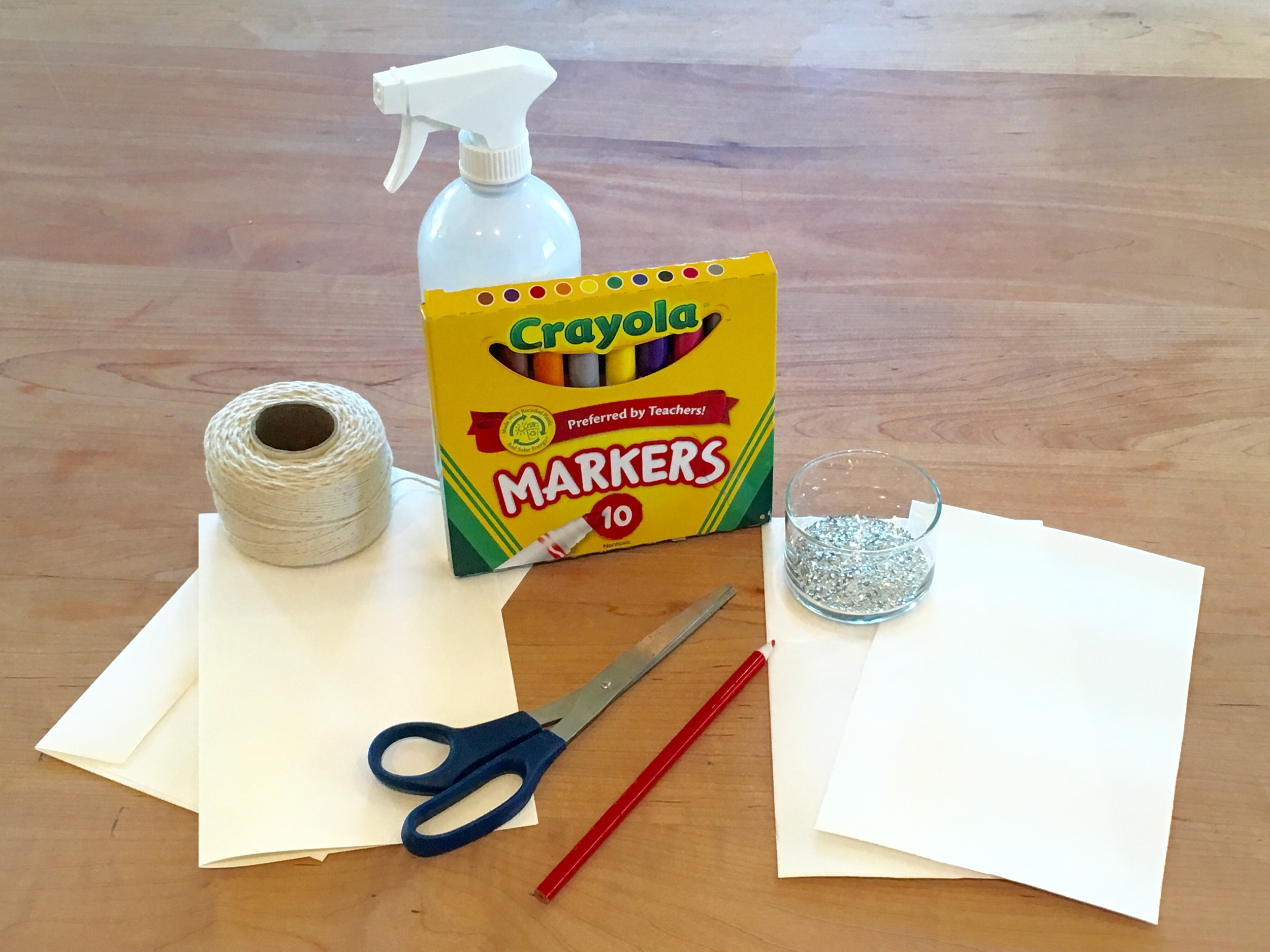 Foam board, notecards and envelopes, pencil, markers, and a water bottle. You may need scissors if your foam and notecards are not the same size. Glitter and twine are optional.