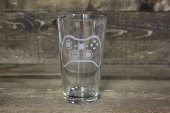 - Celebrate your geek love with an etched glass of your favorite controller. $17.95Check It Out