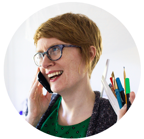 Yup, that's me, excited to get on the phone to support YOU! And yes, I do hold a handful of paintbrushes and markers whenever I talk on the phone.