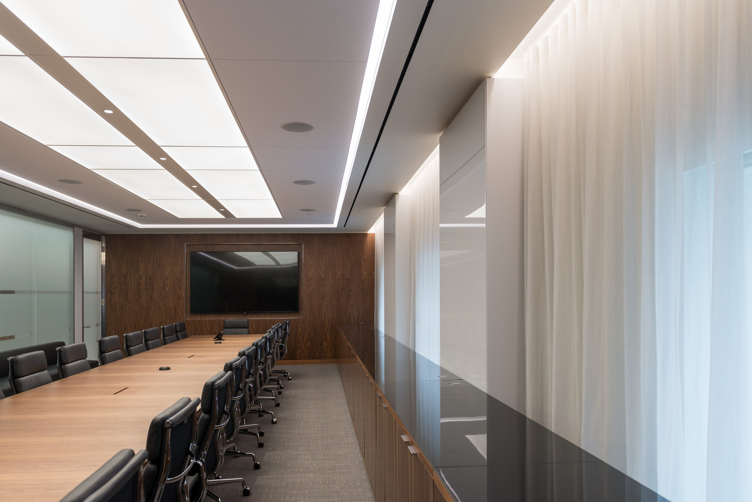 Walnut veneer AV wall to one of several large meeting rooms.