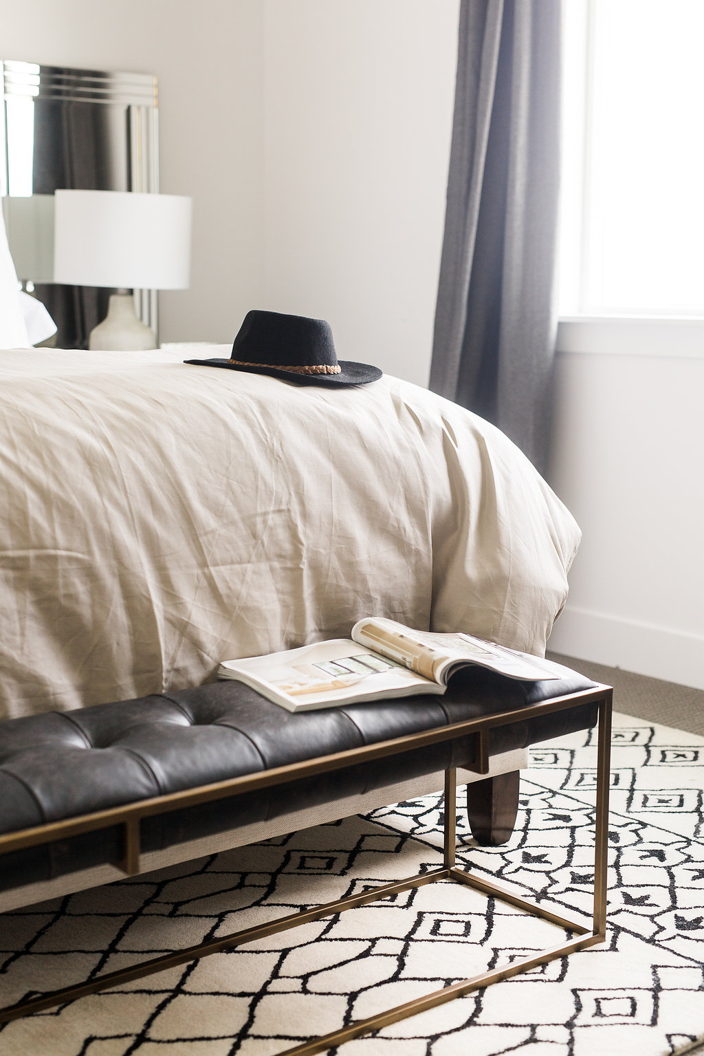 Akin Design Studio | Ironhorse Master Bedroom | Black and gold