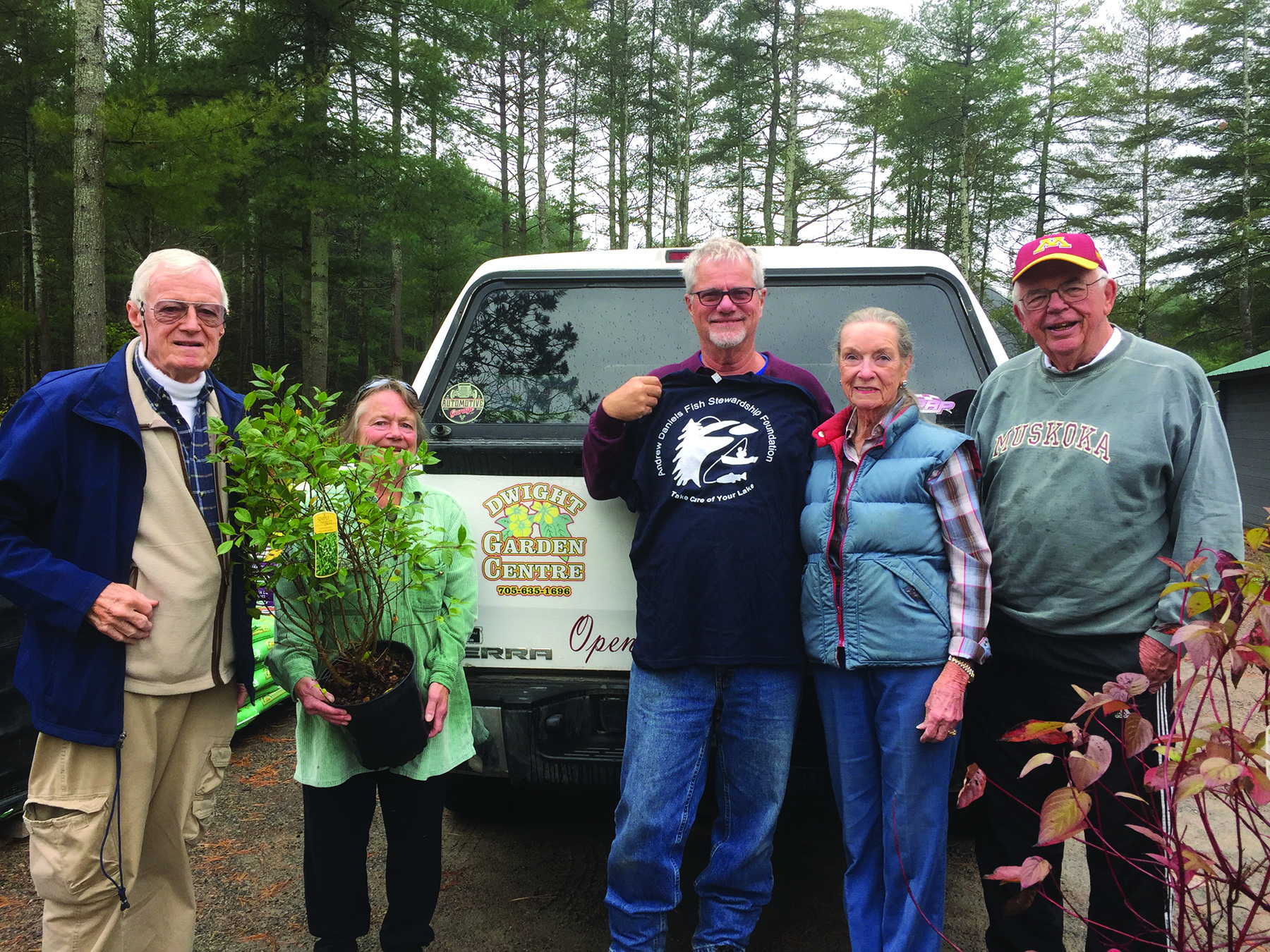George Daniels, Daphne Curtis, Dennis Rolland, Cathy Nystrom and Andy Montgomery obtaining native plants from Dwight Garden Centre.