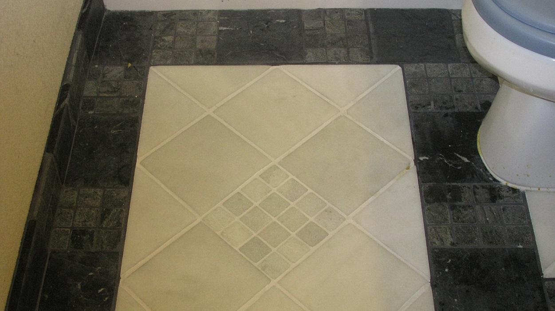 Floor in front of toilet.JPG
