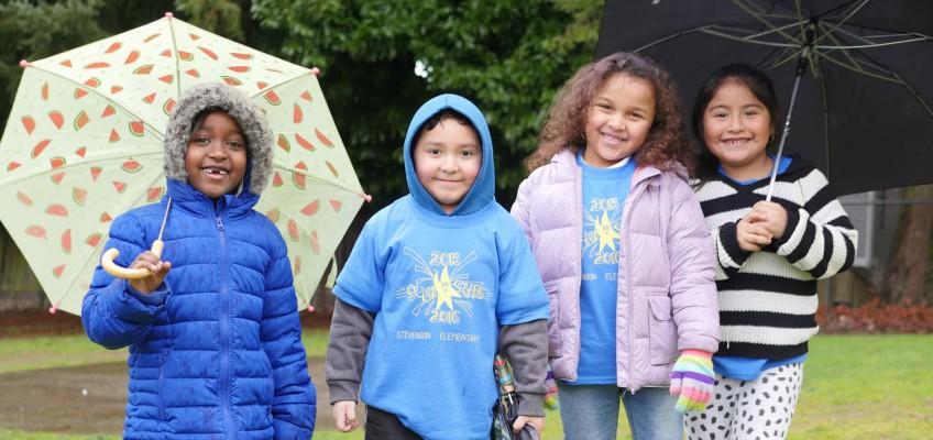 Jubilee REACh Stevenson-Students-with-Umbrellas.jpg
