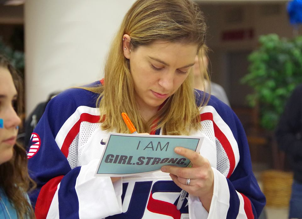 USA Hockey National Team Member signs autographs