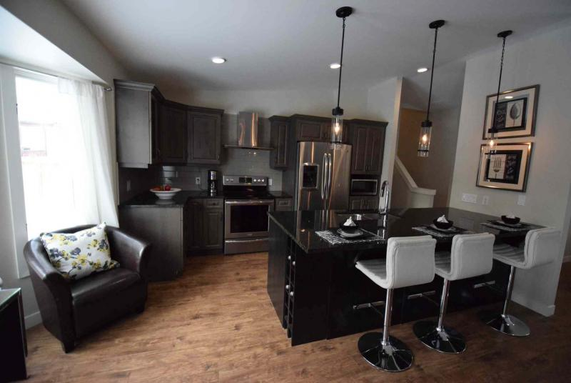 TODD LEWYS / WINNIPEG FREE PRESS/A large island provides separation between the kitchen and dining area.