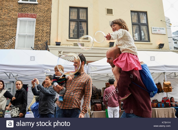 Children and parents playing with bubbles london Alamy Photo.jpg