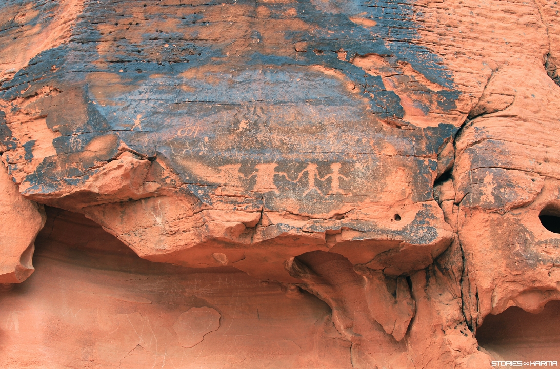 Ancient petroglyphs along with modern day petroglyph scribes.