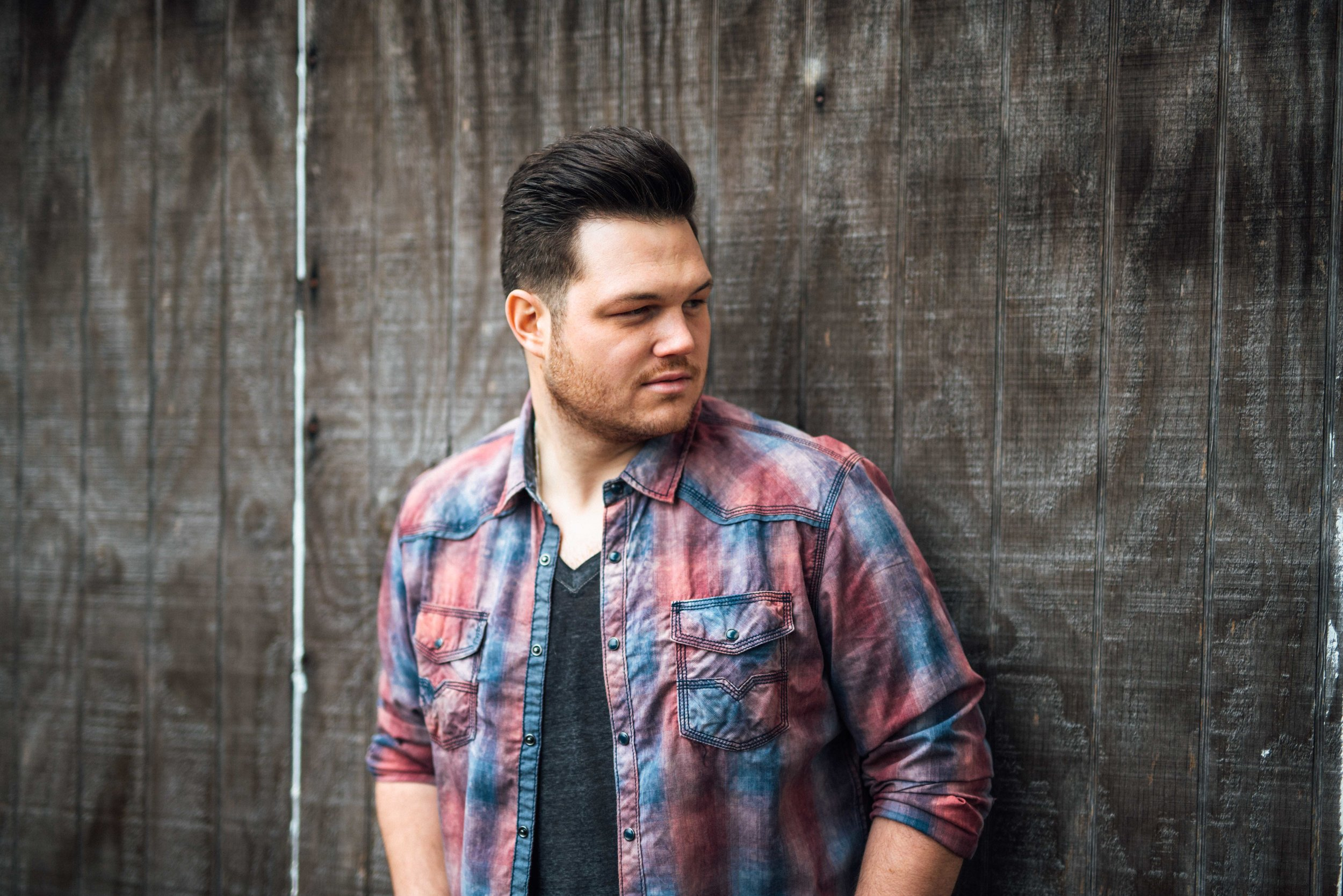 """Born and raised in central Oregon, the first years of AJ's life were spent touring the Pacific Northwest with his family sharing gospel music. He began recording at age 3, had his own band at age 10, and has been moving forward with his music ever since.  While still living in Oregon, songwriter, Tim Johnson (""""I Let Her Lie"""" by Daryle Singletary, """"God Only Cries"""" by Diamond Rio, """"Do You Believe Me Now"""" by Jimmy Wayne…) took AJ under his wing (age 21), and said """"I'd put you in the top 2% vocally in Nashville and if your serious about your music, you need to move here"""". A few months later AJ packed his truck and never looked back. AJ was quickly given the stage at the legendary Bluebird Cafe by heavyweight singer/songwriter, Bernie Nelson (cuts by Conway Twitty, Chrystal Gayle, Trace Adkins, Kenny Chesney, Wynonna, Pam Tillis, Mark Wills, Oak Ridge Boys, Collin Raye… to name a few). Bernie has been known to recognize and champion, raw, undiscovered talent (Garth Brooks, Kenny Chesney… ). Bernie says """"There will always be a place in country music for new artists to catch the wave of others and ride it for a short while and gain illusional success. AJ Kross will not be one of those entertainers because a singer sings songs, while an artist interprets life through words and music. AJ Kross is an artist.""""  AJ's 5 song debut EP, """"People Gonna Talk"""", has people doing just that. Whether fans are commenting on his tone, delivery or the live sound, we believe your going to love this """"New, Old Country Music"""" produced by two of Nashville's most thorough and talented producers, The Time Keepers. Steffon, of The Time Keepers, says """"AJ Kross is one of the best natural singers I've come across in my 15 years in Nashville. He makes melody sound effortless. But what separates AJ the most is his self-awareness artistically. He knows who he is, what he has to say, and how he wants to say it."""" Another recent quote by producer/song writer Jeff Anderson, """"AJ has one of the best voices to e"""