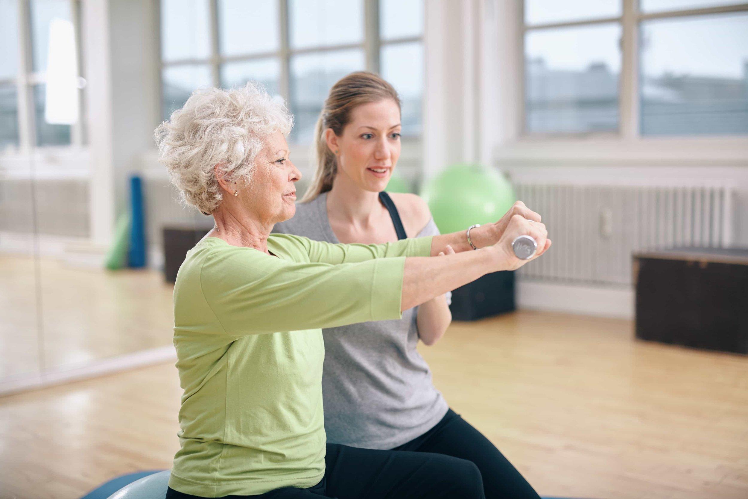 Woman doing post surgery rehab exercises