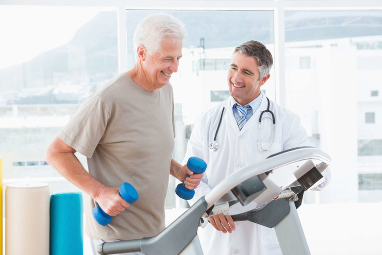 man with doctor doing physical therapy