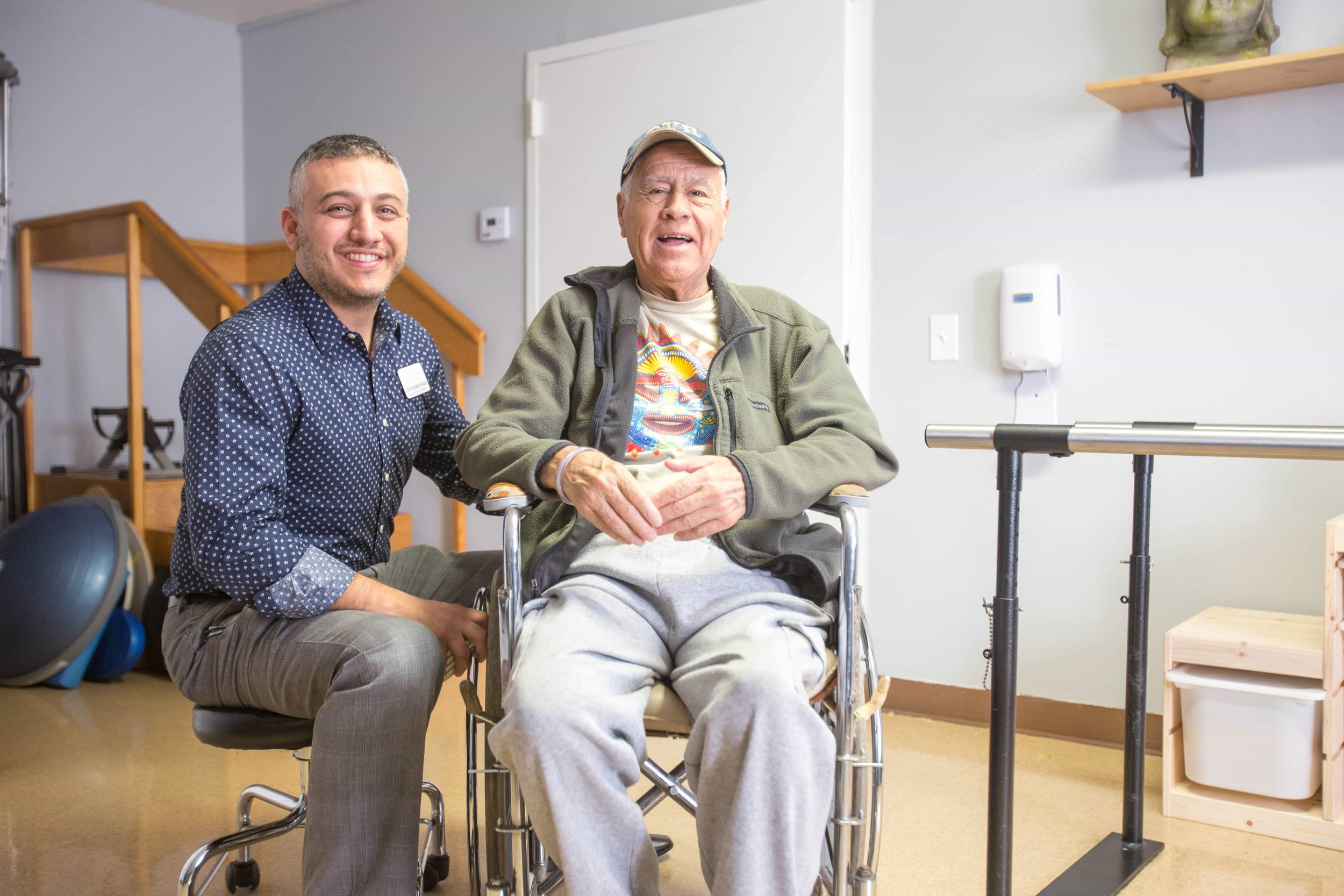 man in wheelchair at health center getting therapy