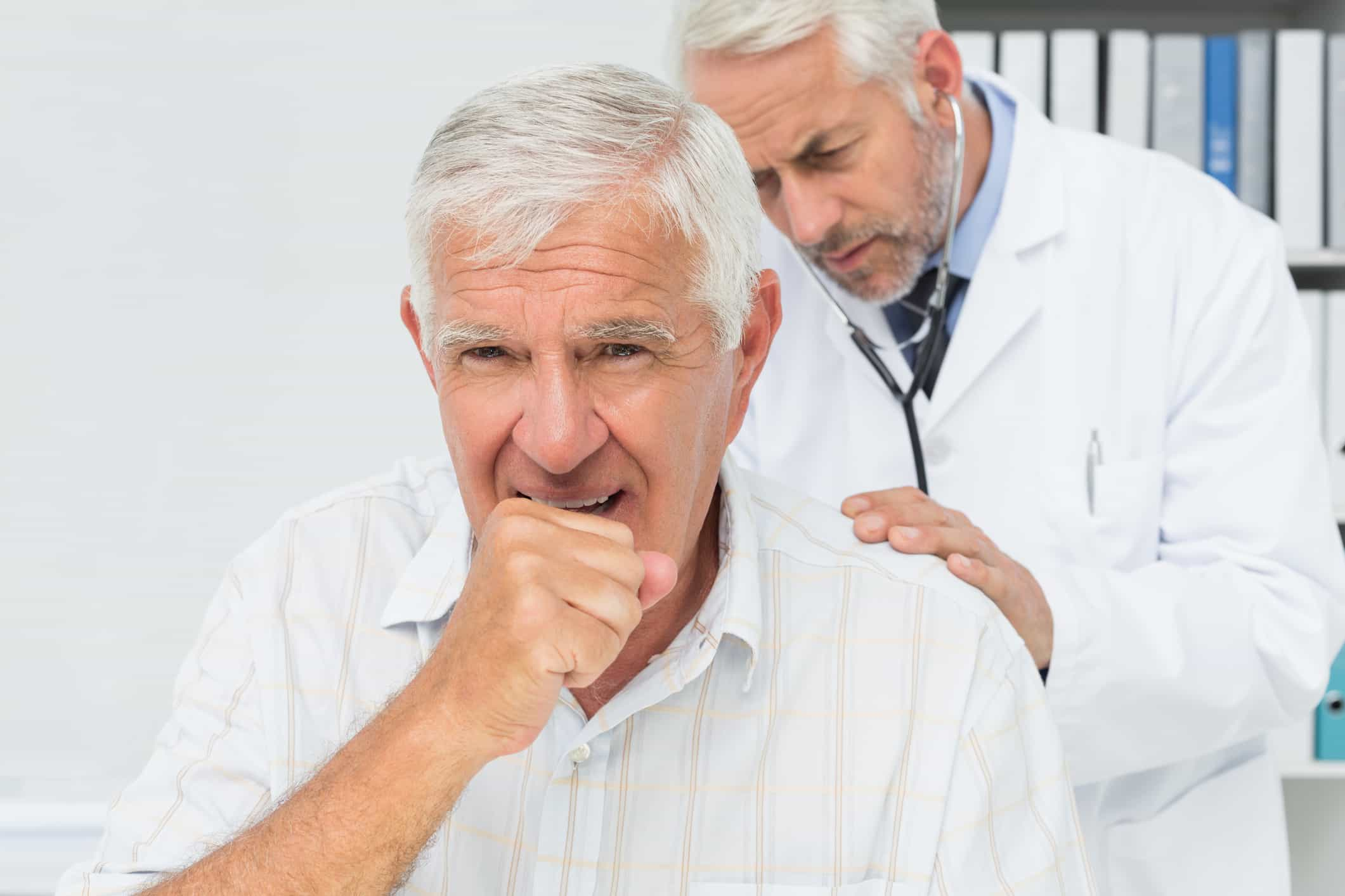 man at the doctor for pneumonia