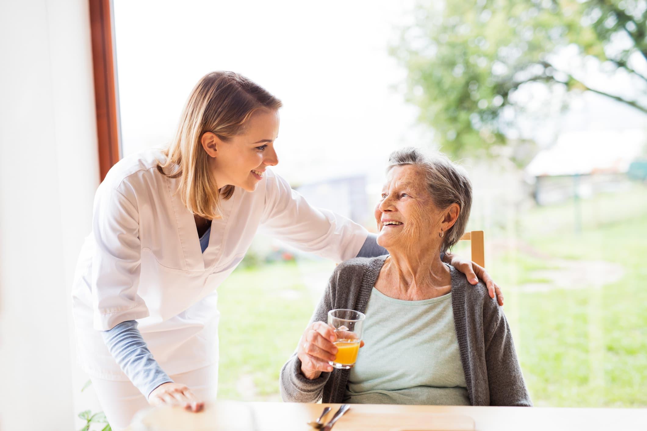senior-woman-talking-with-nurse