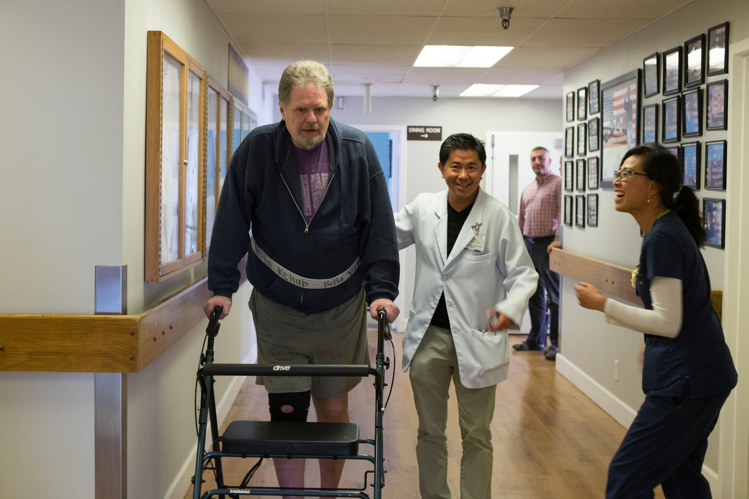 man-walking-in-physical-therapy