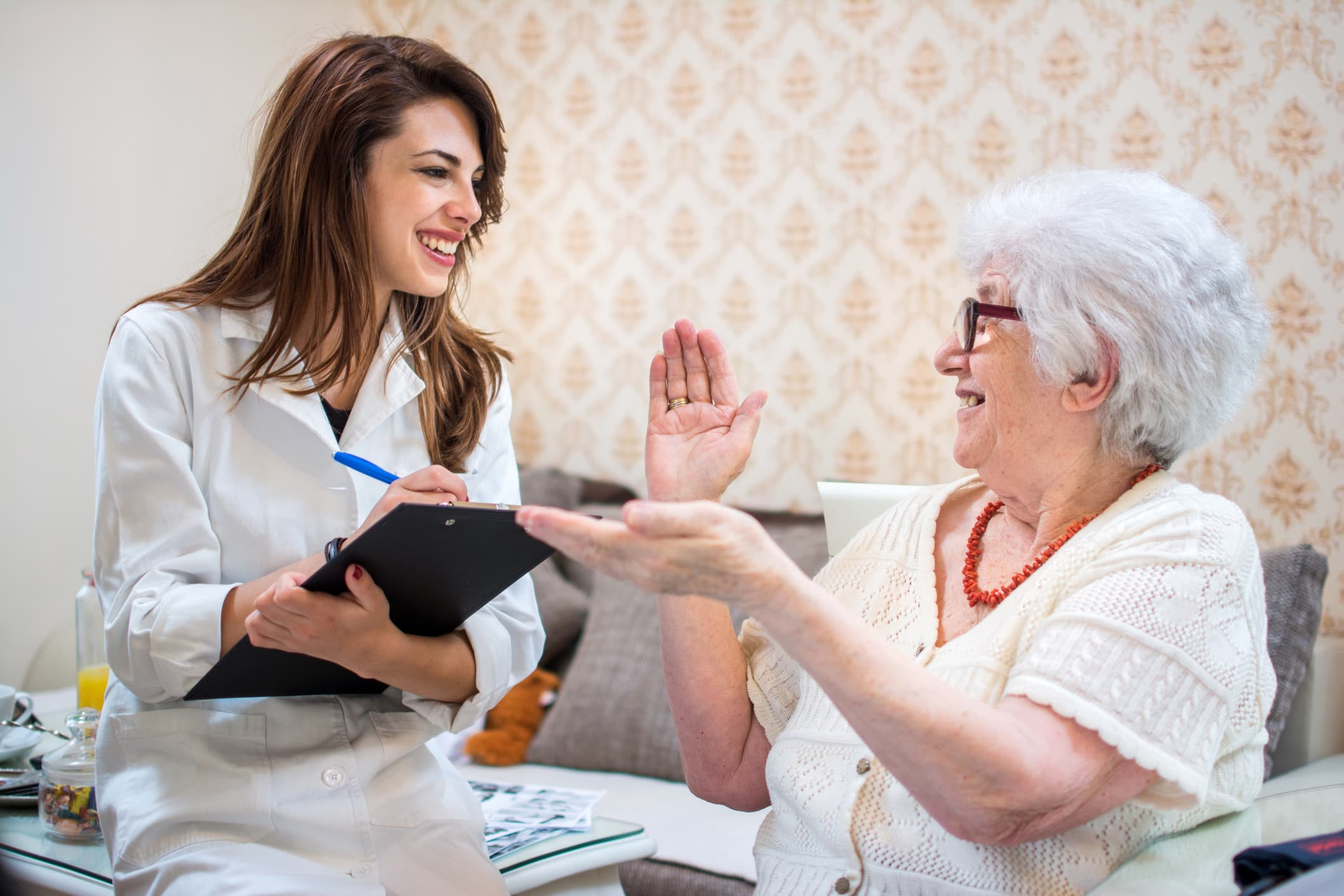 doctor-visiting-elderly-woman-at-home