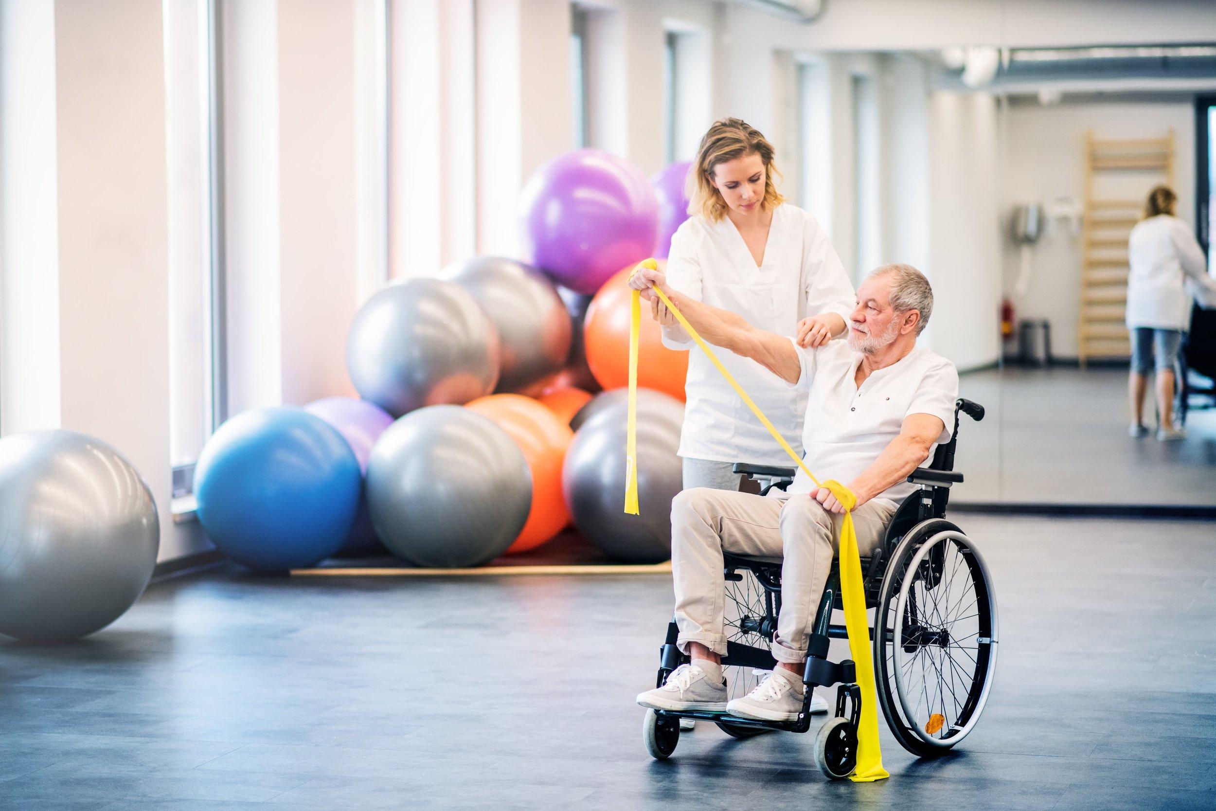 nurse-doing-therapy-exercises-with-senior