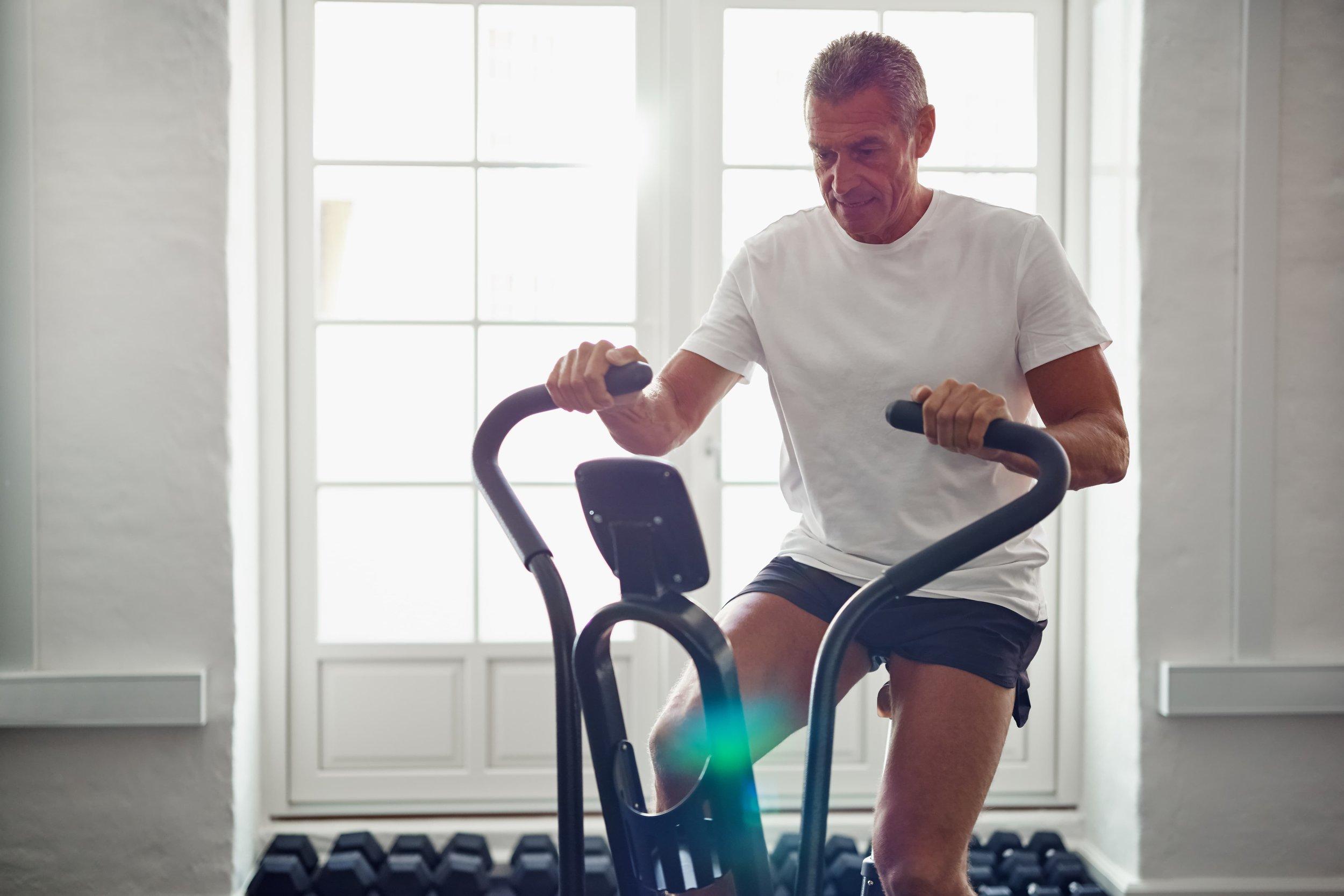man-exercising-on-cycling-machine