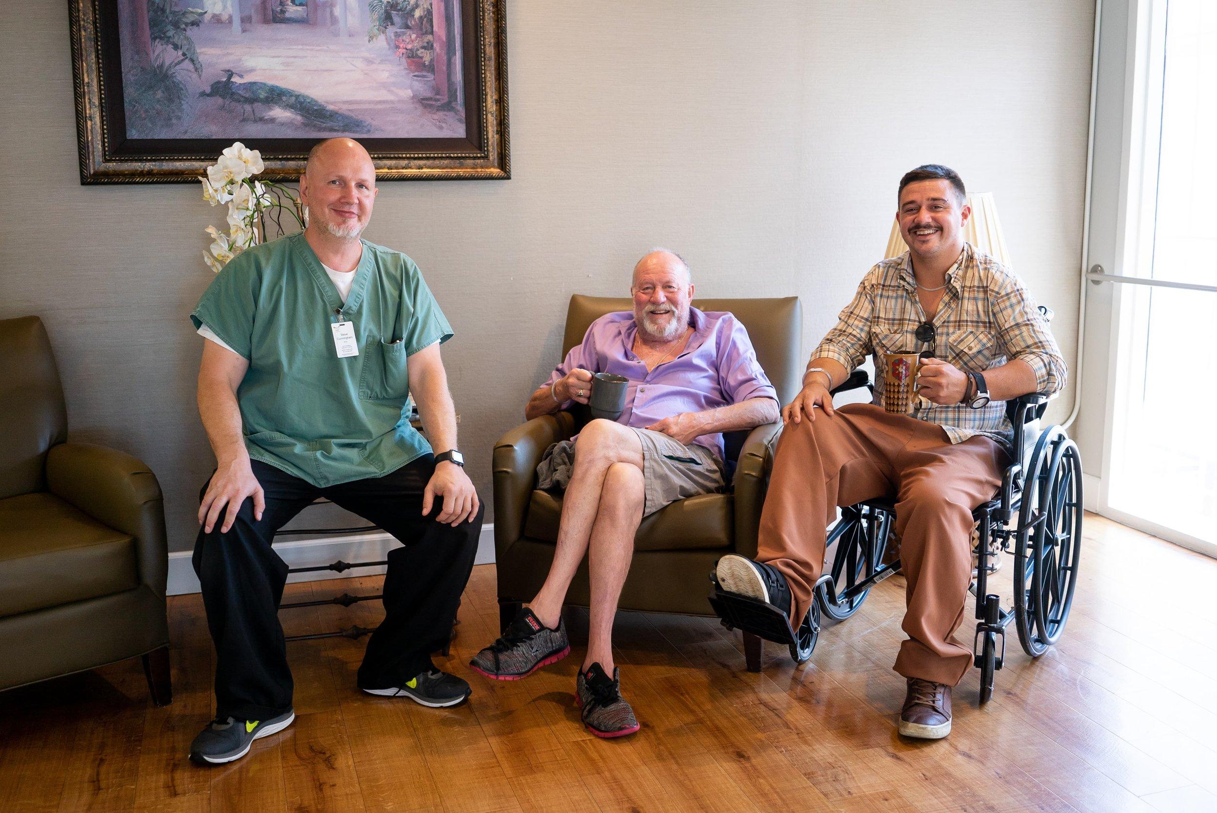 three-men-smiling-in-a-skilled-nursing-facility